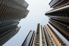 Hong Kong sky-scrapers. Three sky-scrapers of Hong Kong on a   skybackground Stock Photography