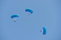 Three skydivers stock photo