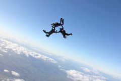 Three skydivers after existing an airplane. Three skydivers in freefallThree skydivers in freefall Stock Image