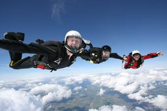 Three skydivers form a line Royalty Free Stock Photos