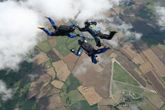 Three skydivers in freefall. Performaing formations Royalty Free Stock Photography