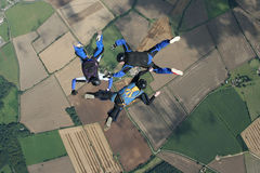 Three skydivers in freefall. Performaing formations Royalty Free Stock Images