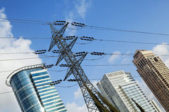 Skyscraper Tops & High Voltage Power Line. Three skyscrapers and a high voltage power line, depicted in a tilted angle Stock Photos