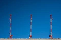 Three skyscrapers on top. Three sky scrapers on top of a tall Hakata station in Fukuoka, Japan, with blue sky stock image