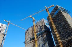Three skyscrapers under construction Royalty Free Stock Images