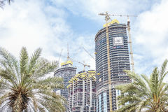 Three skyscrapers under construction in Dubai. royalty free stock images