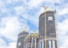 Three skyscrapers under construction in Dubai. stock photography