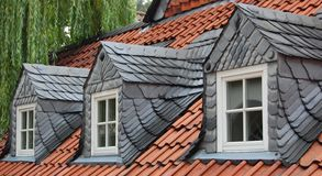 Three slate dormer windows Stock Photography