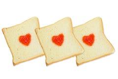 Three slice breads with fruit jam heart shape . Three slice breads with fruit jam heart shape  on white background Royalty Free Stock Photo