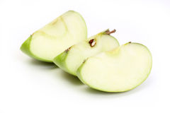 Three slice a green apple. On white background Stock Photos