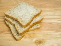 Three slice whole wheat bread on wooden table Royalty Free Stock Photography