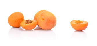 Three sliced apricots  on white Royalty Free Stock Image