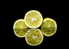 Three Sliced Lemons Royalty Free Stock Images