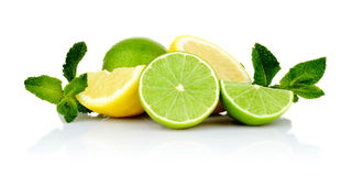 Three sliced lemons with limes with mint Royalty Free Stock Images