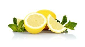 Three sliced lemons with mint isolated on a white background Stock Photography