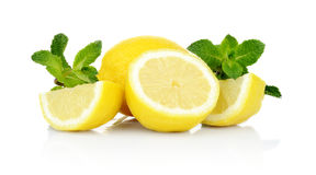 Three sliced lemons with mint isolated on a white background Stock Images