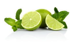 Three sliced limes with mint isolated on a white background Royalty Free Stock Photography
