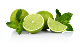 Three sliced limes with mint isolated on a white background Royalty Free Stock Images