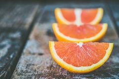 Three Sliced Orange Fruits Stock Photography