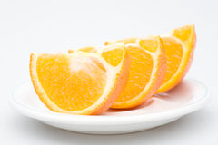 Three sliced orange in the plate, isolated Stock Photos