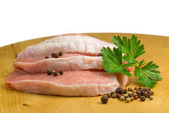 Three sliced pork on a wooden board isolated Royalty Free Stock Photo