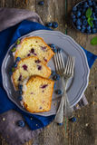 Three slices of blueberry cake with sugar icing and fresh berrie Royalty Free Stock Photo