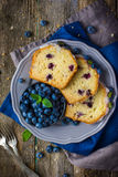 Three slices of blueberry cake with sugar icing and fresh berries Royalty Free Stock Photo
