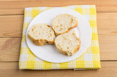 Three slices of bread in glass plate on yellow napkin Royalty Free Stock Images