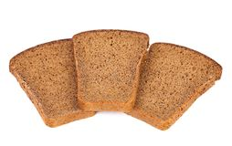 Three slices of brown bread. Isolated on white Royalty Free Stock Image