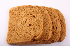 Three slices of brown bread Stock Photos