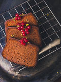 Three slices of chocolate cake. In a rustic setup Stock Photos