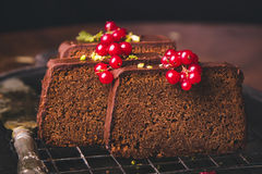 Three slices of chocolate cake. In a rustic setup Royalty Free Stock Photography