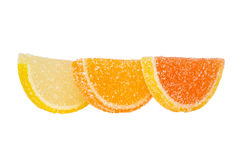 Three Slices Of Colored Marmalade Stand One Behind Another On A White Background Royalty Free Stock Photography