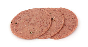 Three slices of cotto salami Stock Images