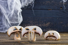 Three slices of Halloween champignons Stock Images