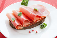 Three slices of jamon on bread Stock Photo
