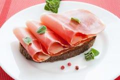 Three slices of jamon on bread Stock Photo