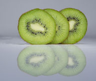 Three slices of a kiwi Stock Images