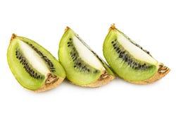 Three slices of kiwi isolated on white Stock Photography