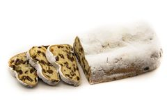 The three slices and the main part of Stollen isolated on a white background. Traditional German Christmas cake with marzipan and stock photo