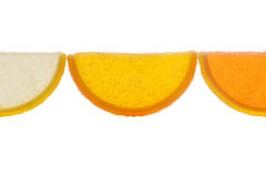 Three Slices Of  Marmalade Illuminated From Behind On A White Ba. Three slices of yellow and orange marmalade sprinkled with granulated sugar illuminated from Royalty Free Stock Photography