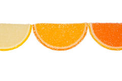 Three Slices Of  Marmalade On A White Background. Three slices of yellow and orange marmalade sprinkled with granulated sugar on a white background Royalty Free Stock Photo