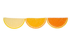 Three Slices Of  Marmalade On A White Background. Three slices of yellow and orange marmalade sprinkled with granulated sugar on a white background Stock Photo