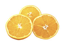 Three slices of orange2. Closeup studio photo of  orange slices  nice and juicy isolated in the middle of white background Royalty Free Stock Photos