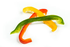 Three slices of red, yellow and green bell peppers Royalty Free Stock Photo