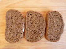 Three slices of rye bread Stock Photos