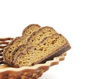 Three slices of rye bread in bread-basket on white, , Royalty Free Stock Images