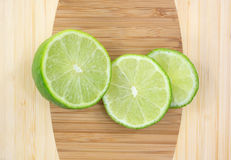 Three Slices Of Tart Green Limes Up Close Royalty Free Stock Photos