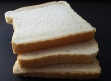 Three slices of toast. Sliced bread suitable for toasting. royalty free stock image