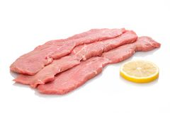 Free Three Slices Veal Cutlet And Lemon Stock Images - 134105524